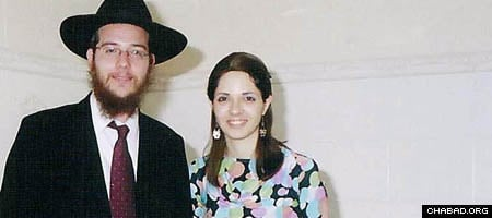 Rabbi Gavriel, left, and Rivkah Holtzberg were killed in one of the worst terrorist attacks in Indian history. Here, they're seen attending to the wedding of a local Jewish couple.
